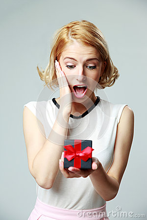 Free Woman Holding An Open Jewelery Gift Box Royalty Free Stock Image - 40889076