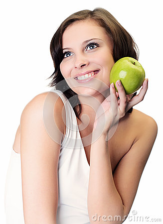 Woman holding apple against white
