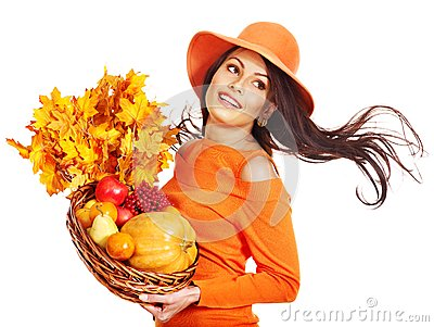 Woman holding autumn basket.