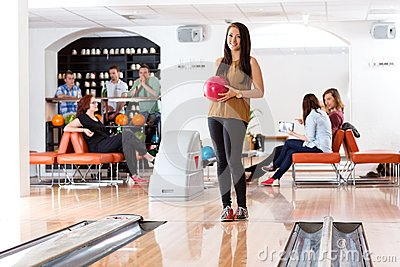Woman Holding Ball in Bowling Alley