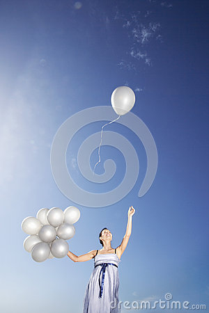 Woman Holding Balloons With One Flying Away Royalty Free ...