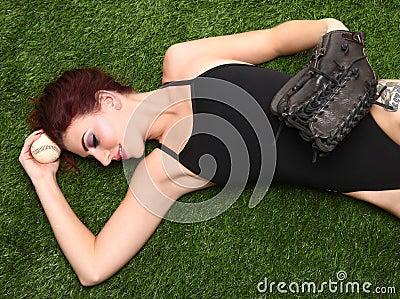 Woman Holding Baseball Sports Gear on Grass