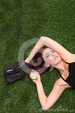 Woman Holding Baseball Sports Gear on Grass