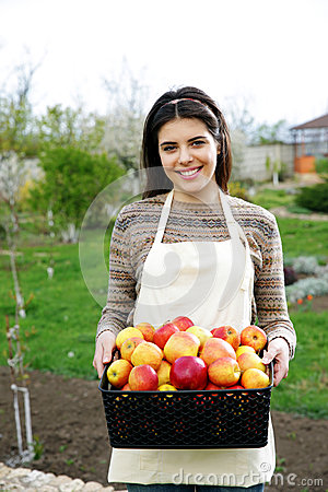 Woman holding basket with apples