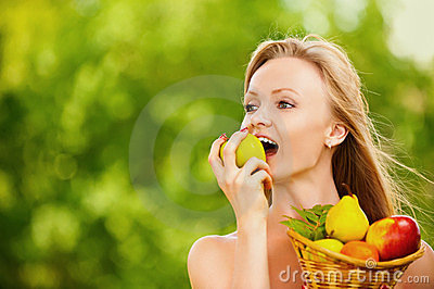 Woman holding basket full of fruits