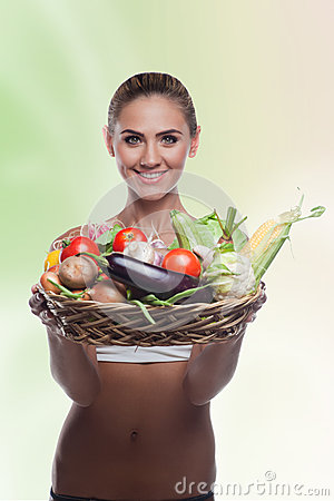 Woman holding basket with vegetable