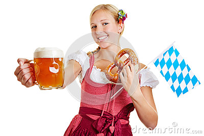 Woman holding beer, pretzel and bavarian flag