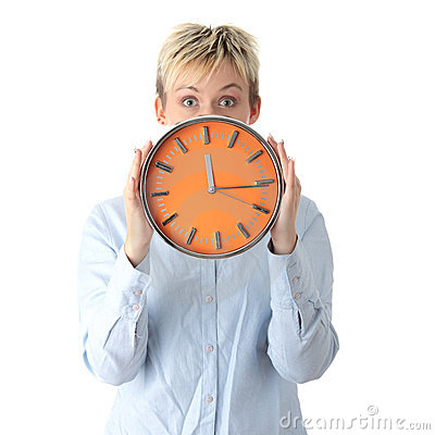 Woman holding big alarm clock