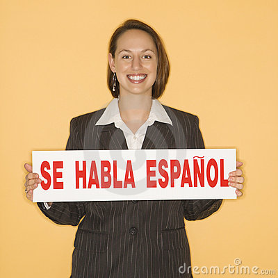Free Woman Holding Bilingual Sign Royalty Free Stock Photo - 2431885