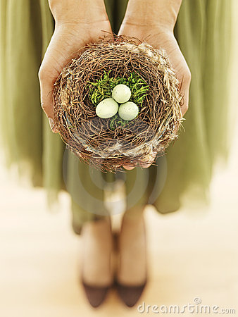 Woman holding bird nest