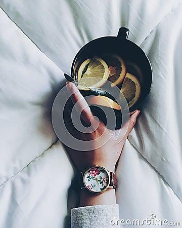 Woman Holding Black Ceramic Mug With Sliced Lemon On Top Of White Bed Comforter Free Public Domain Cc0 Image