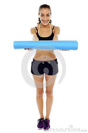 Woman holding a blue mat in her outstretched arms
