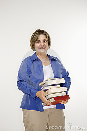 Woman holding books.