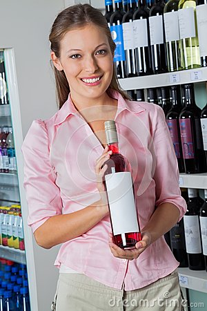 Woman Holding Bottle Of Alcohol At Supermarket