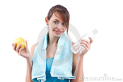 Woman holding bottle of water and apple