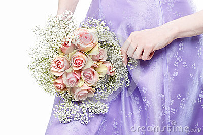 Woman holding bouquet of pink roses