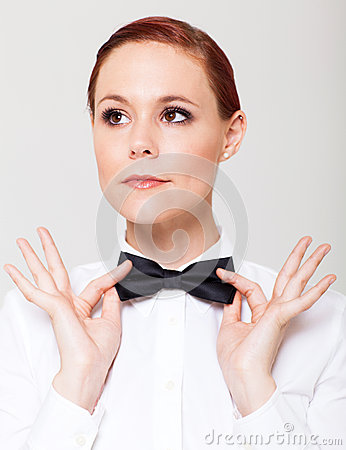 Woman holding bow tie