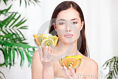 Woman holding bowls full of fruit
