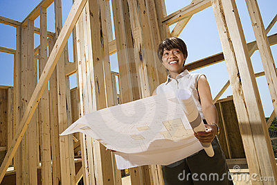 Woman Holding Building Plans