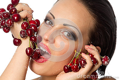 Woman holding a bunch of red cherries