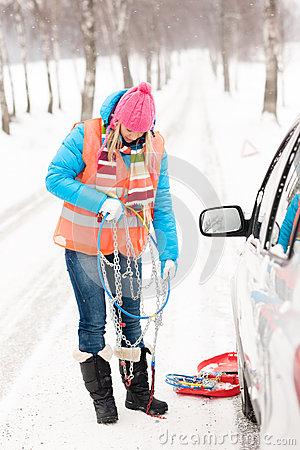 Free Woman Holding Car Chains Winter Tire Snow Stock Images - 27155594
