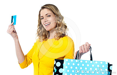 Woman holding cerdit-card with shopping bags