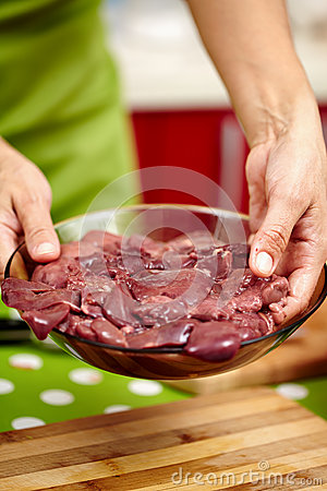 Woman holding chicken liver