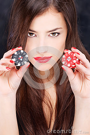 Woman holding chips for gambling
