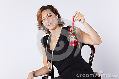 Woman holding christmas bell