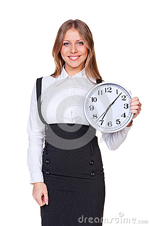 Woman holding the clock and looking at camera