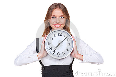 Woman holding the clock and smiling
