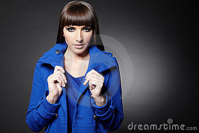 Woman Holding Coat Collar Stock Image - Image: 22099581