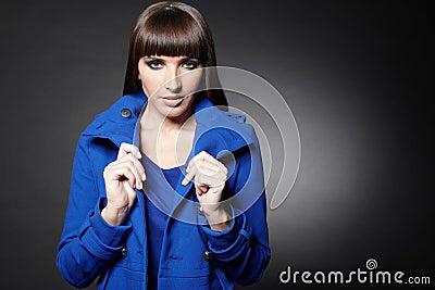 Woman holding coat collar