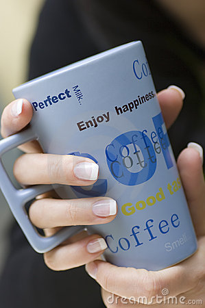 Free Woman Holding Coffee Cup Stock Photography - 4883562