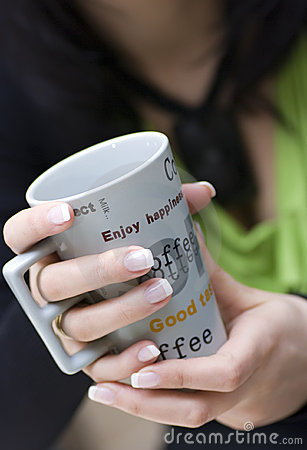 Free Woman Holding Coffee Cup Stock Photo - 4883650