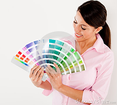 Woman holding a color scale guide