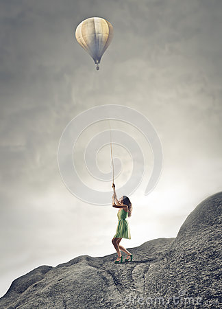 Woman holding a baloon