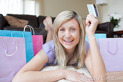 Woman holding a credit card after shopping