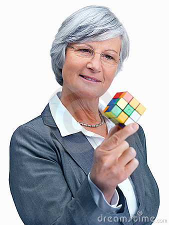 Woman holding a cube thinking about something