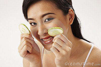 Woman Holding Cucumber Slice