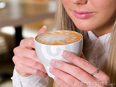 Woman holding a cup of hot drink