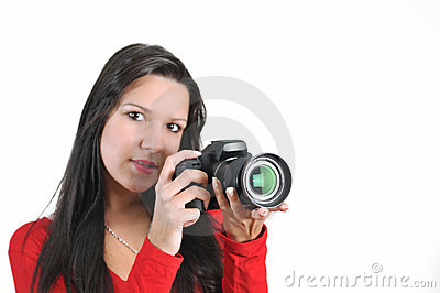 Woman holding DSLR camera in hand