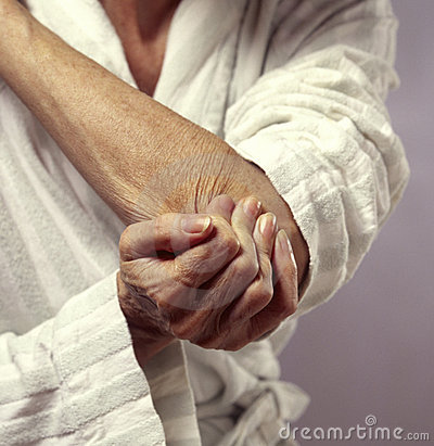 Woman holding elbow in pain