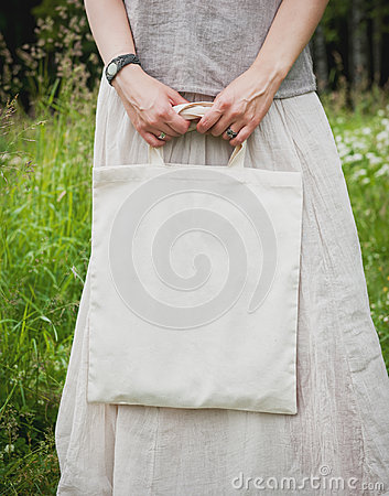 Free Woman Holding Empty Linen Bag. Template Mock Up Stock Photos - 97102013