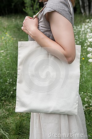 Free Woman Holding Empty Linen Bag. Template Mock Up Stock Images - 99514004