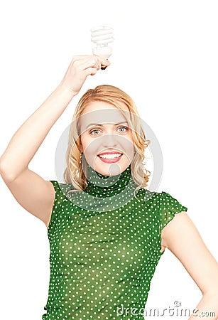 Woman holding energy saving bulb Stock Photo