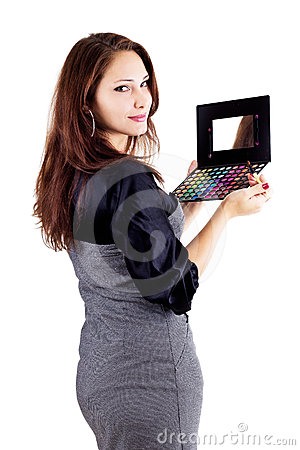 Woman holding eyeshadow set