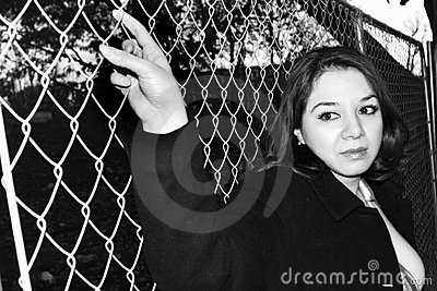 Woman holding a fence
