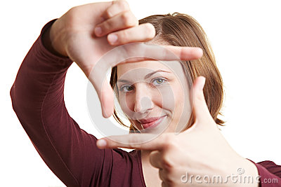 Woman holding fingers as a frame