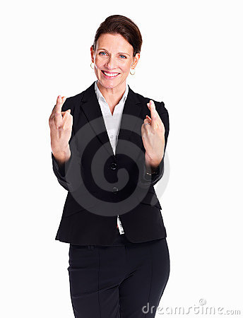 Woman holding fingers crossed with a big grin
